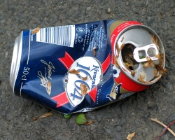 An empty crushed beer can