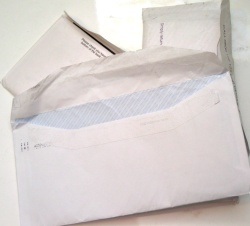 How can I reuse or recycle used envelopes?