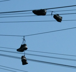 Two pairs of shoes slung over a telephone wire in Leeds