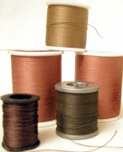 Reels of cotton on plastic bobbins