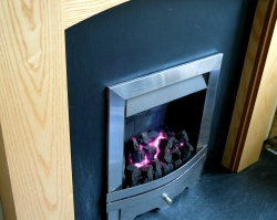 A fireplace with gas fire