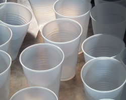 How can I reuse or recycle plastic cups?