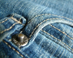 A pocket on a pair of denim jeans
