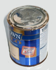 How can I reuse or recycle empty paint tins?