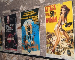 How can I reuse or recycle old movie posters?