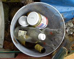 How can I make a waterproof(ish) recycling bin from recycled stuff?