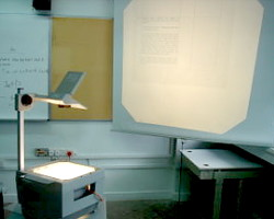 How can I reuse or recycle overhead projector transparencies?