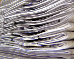 How can I reuse or recycle old photocopied paper?