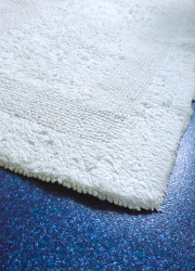 How can I reuse or recycle an old bath mat?
