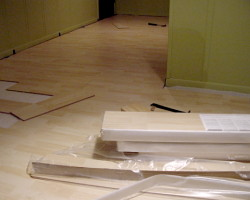 How can I reuse or recycle laminate wooden flooring?