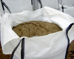 How can I reuse or recycle bulk building material bags?