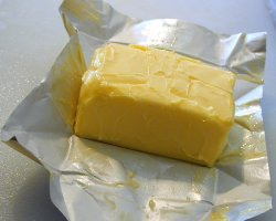 How can I reuse or recycle butter wrappers?