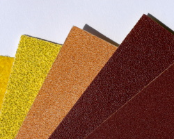 How can I reuse or recycle worn out sandpaper?