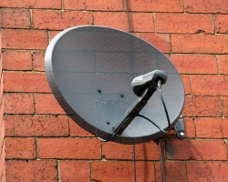 How can I reuse or recycle old satellite dishes?
