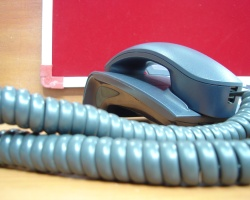 How can I reuse or recycle old telephones?