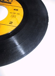 How can I reuse or recycle old vinyl 45s?